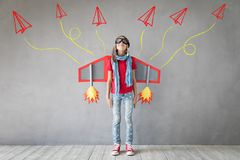 Happy child playing with toy jetpack royalty free stock photos