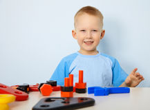 Happy child playing with toys Stock Photo
