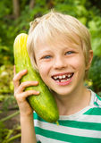 Happy child playing in vegetable garden Royalty Free Stock Photos