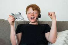 Happy Child Playing Videogames Royalty Free Stock Images