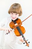 Happy child playing violin. Happy adorable child playing violin Royalty Free Stock Photos