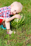 Happy child playing with watermelon outdoors Stock Photos