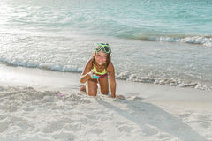 Happy  child playing on white sand tropical beach Royalty Free Stock Image