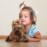 Happy child playing with Yorkie Royalty Free Stock Photo