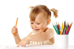 Happy child points on her drawing and smile Stock Photography
