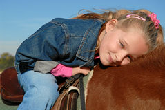 Happy Child on pony Stock Photos