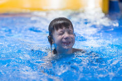 Happy child in pool at aqua park royalty free stock image