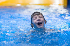 Happy child in pool at aqua park royalty free stock photography