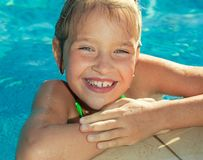 Happy child at pool royalty free stock photo