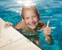 Happy child at pool stock photos