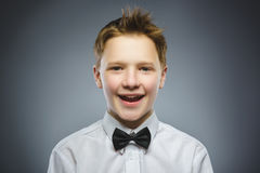 Happy child. Portrait of handsome boy smiling on grey background royalty free stock images