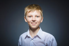Happy child. Portrait of handsome boy smiling isolated on grey background stock image