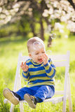 Happy child. Portrait of little boy playing with bubbles Stock Photo