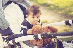 Happy child in pram in sunny day outside Royalty Free Stock Images