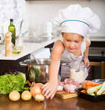 Happy child prepared soup with vegetables Stock Photography