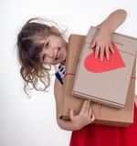 Little smiling girl holding present box isolated on white. stock photography