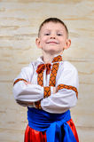 Happy child proud to wear the Ukrainian costume Stock Photography