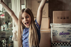 Happy child raise hands up and saying yes Stock Photo