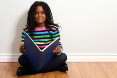 Happy child reading a book Stock Photos
