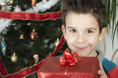 Happy child receive the gift of Christmas Stock Photography