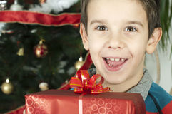 Happy child receive the gift of Christmas Stock Image