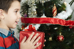 Happy child receive the gift of Christmas Stock Photos