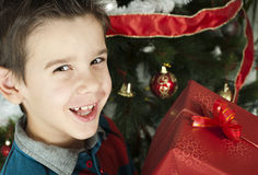 Happy child receive the gift of Christmas Royalty Free Stock Photography