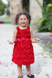 Happy child in a red dress Royalty Free Stock Photos