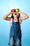 Happy Child with red and green apple royalty free stock image