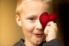 Happy child with red heart Royalty Free Stock Photo