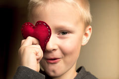 Happy child with red heart Stock Images