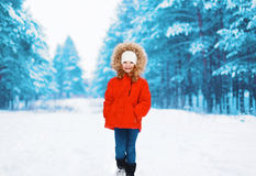 Happy child in red jacket walking in winter Royalty Free Stock Photos
