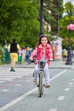 Cute kid in safety helmet biking outdoors. Little girl on a red bicycle Healthy preschool children summer activity. Royalty Free Stock Photos