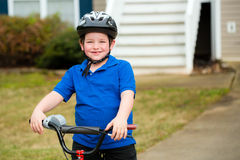 Happy child riding his bike Royalty Free Stock Photo