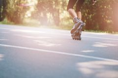 Happy child rollerblading on a sunny day Royalty Free Stock Image