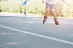 Happy child rollerblading on a sunny day Royalty Free Stock Images