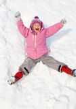 Happy child rolling down the hills in winter park Stock Photos