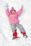 Happy child rolling down the hills in winter park Royalty Free Stock Images