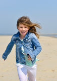 Child running on the beach Royalty Free Stock Photo