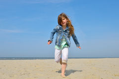 Happy child running on the beach Royalty Free Stock Photo