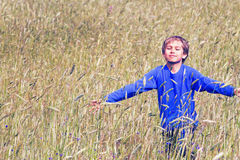Happy child running on beautiful field Stock Photo
