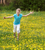 Happy child  running in  field. Royalty Free Stock Images
