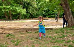 Happy child running in nature royalty free stock photo