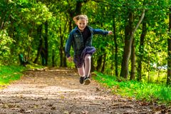 Running child. Happy child running through the park Royalty Free Stock Photos