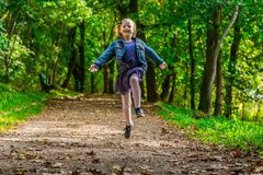 Running child. Happy child running through the park Royalty Free Stock Photography