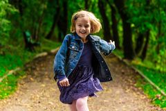 Running child. Happy child running through the park Royalty Free Stock Photo