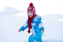 Happy child, running in the snow, winter Stock Photography