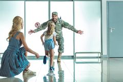 Happy child running to father in military uniform Stock Photo