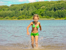 Happy Child Runs On Water Royalty Free Stock Images
