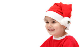 Happy child in santa claus hat Stock Photos